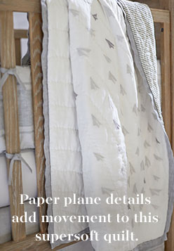Paper plane details add movement to this supersoft quilt.