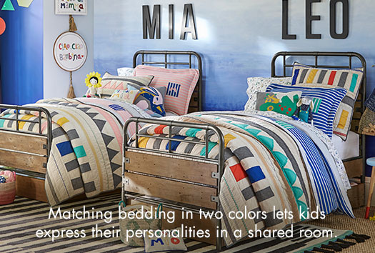 Matching bedding in two colors lets kids express their personalities in a shared room.